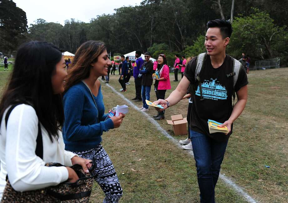 Mathew Lew attempts to hand out maps at Outside Lands Music Festival in Golden Gate Park on August 10, 2014 in San Francisco, CA. Photo: Craig Hudson, The Chronicle