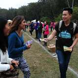 Mathew Lew attempts to hand out maps at Outside Lands Music Festival in Golden Gate Park on August 10, 2014 in San Francisco, CA.
