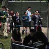 Festival attendees walk to the entrance of Outside Lands Music Festival in Golden Gate Park on August 10, 2014 in San Francisco, CA.