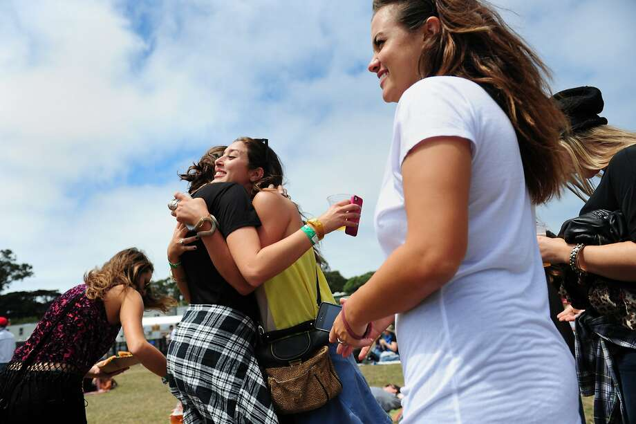Kelsey Rudd, left, hugs Margaux Vigier during Imelda May's performance on the Lands End stage at Outside Lands Music Festival in Golden Gate Park on August 10, 2014 in San Francisco, CA. Photo: Craig Hudson, The Chronicle