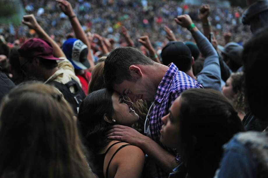 Isaac Maycock and Petra de Matran embrace during Atmoshpere's performance on Sutro stage at Outside Lands Music Festival in Golden Gate Park on August 09, 2014 in San Francisco, CA. Photo: Craig Hudson, The Chronicle