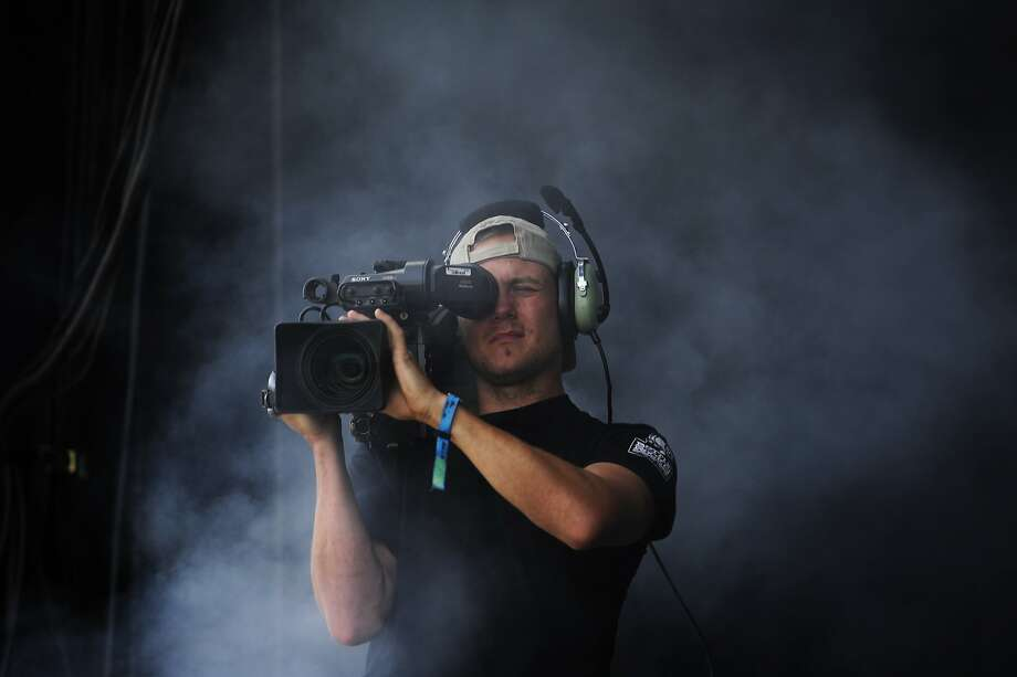 A cameraman is engulfed in smoke as Imelda May performs on the Lands End stage at Outside Lands Music Festival in Golden Gate Park on August 10, 2014 in San Francisco, CA. Photo: Craig Hudson, The Chronicle