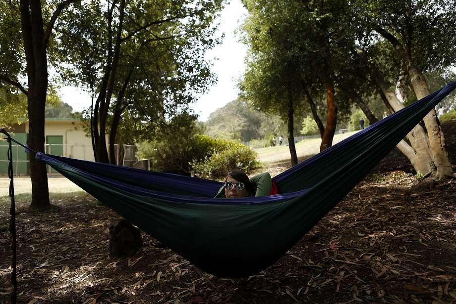 Kelly Miller of Sacramento listens to music from her hammock during Outside Lands festival at Golden Gate Park in San Francisco, Calif. on Sunday, August 10, 2014. Photo: Scott Strazzante, The Chronicle
