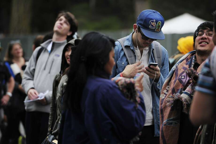 Ian Blackley listens to music on his phone while waiting in line at Outside Lands Music Festival in Golden Gate Park on August 10, 2014 in San Francisco, CA. Photo: Craig Hudson, The Chronicle