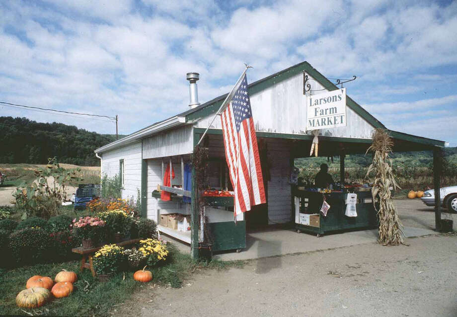 The original Larson Farm stand was once a fixture of summer in New Milford. But after struggling to stay in business the past few years, the family has decided to close its last farm stand at 548 Danbury Road in town. Photo: Norm Cummings / The News-Times