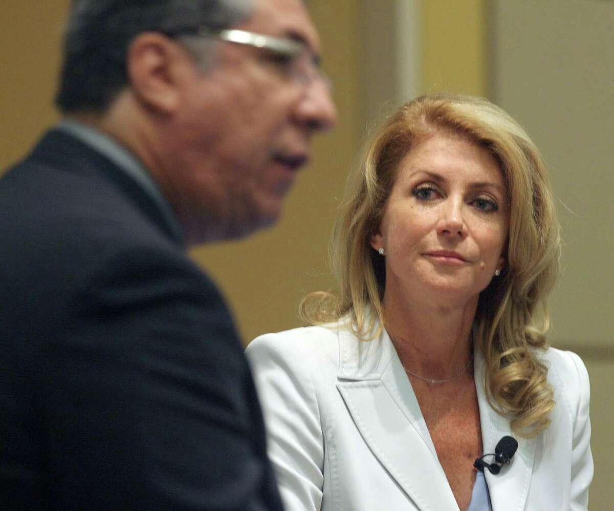 Democratic candidate for governor Sen. Wendy Davis listens as Carlos Sanchez, The Monitor Editor, asks questions during the Newsmakers Breakfast Series at the McAllen Convention Center Thursday, Aug.7, 2014. Davis said Thursday that as governor she would pull Texas National Guard troops from the border if local officials determined they weren't necessary. (AP Photo/The Monitor, Delcia Lopez)