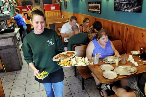 Server Holly McDermott, center, delivers meals to customers on Saturday, Aug. 9, 2014, at Bob's Diner in Watervliet, N.Y. (Cindy Schultz / Times Union)