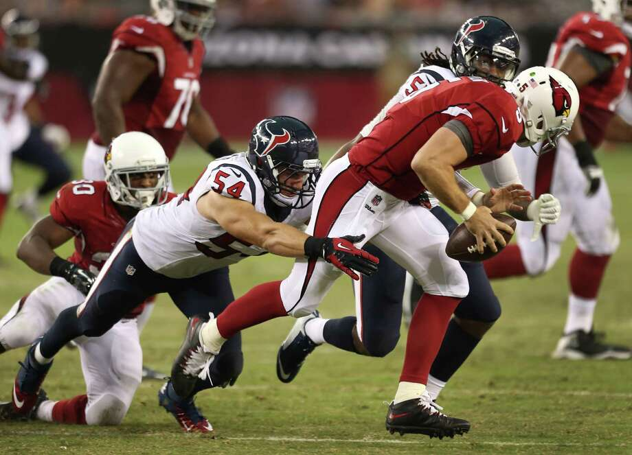 Texans linebackers Mike Mohamed (54) and Justin Tuggle (57) pursue Cardinals quarterback Drew Stanton (5) on Saturday night. The defense had three sacks but forced no turnovers. Photo: Brett Coomer, Staff / © 2014  Houston Chronicle