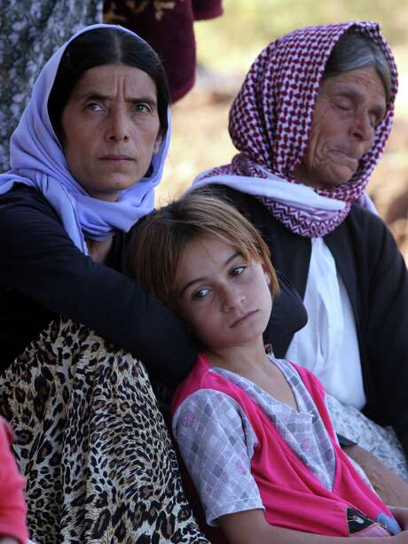 Though thousands of Iraqi Yazidis were able to escape in the wake of American airstrikes and supply drops, tens of thousands remain trapped on Mount Sinjar, where they were driven by an Islamic State dragnet. Photo: AHMAD AL-RUBAYE, Staff / AFP