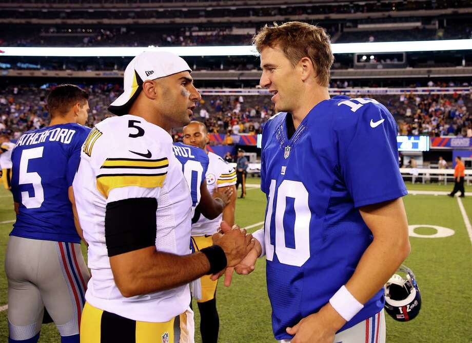 EAST RUTHERFORD, NJ - AUGUST 09: Quarterback Eli Manning #10 of the New York Giants meets with quarterback Bruce Gradkowski #5 of the Pittsburgh Steelers following a preseason game at MetLife Stadium on August 9, 2014 in East Rutherford, New Jersey.  (Photo by Elsa/Getty Images) ORG XMIT: 501328527 Photo: Elsa / 2014 Getty Images