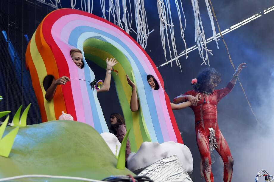 Wayne Coyne of The Flaming Lips leads a dancing rainbow offstage during Outside Lands festival at Golden Gate Park in San Francisco, Calif. on Sunday, August 10, 2014. Photo: Scott Strazzante, The Chronicle