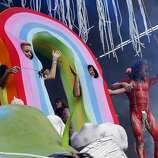 Wayne Coyne of The Flaming Lips leads a dancing rainbow offstage during Outside Lands festival at Golden Gate Park in San Francisco, Calif. on Sunday, August 10, 2014.