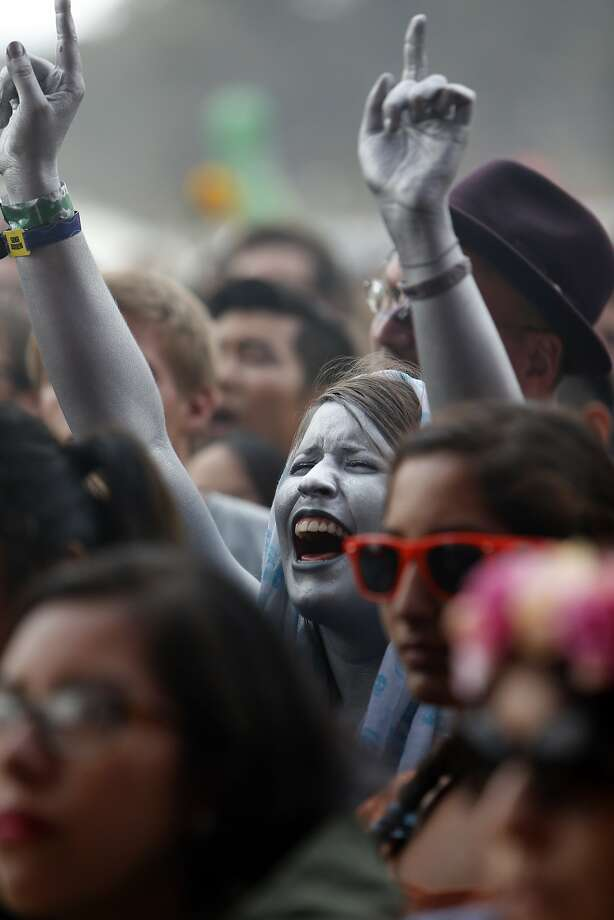 A fan covered in silver body paint enjoys The Flaming Lips during Outside Lands festival at Golden Gate Park in San Francisco, Calif. on Sunday, August 10, 2014. Photo: Scott Strazzante, The Chronicle