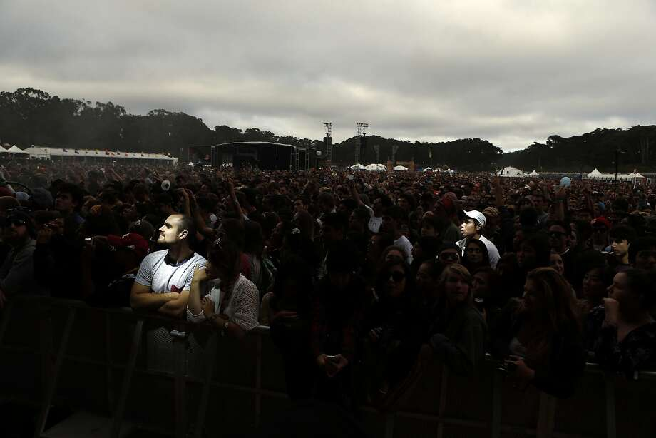 Two men in the crowd are illuminated by stage lights during Flaming Lips show during Outside Lands festival at Golden Gate Park in San Francisco, Calif. on Sunday, August 10, 2014. Photo: Scott Strazzante, The Chronicle