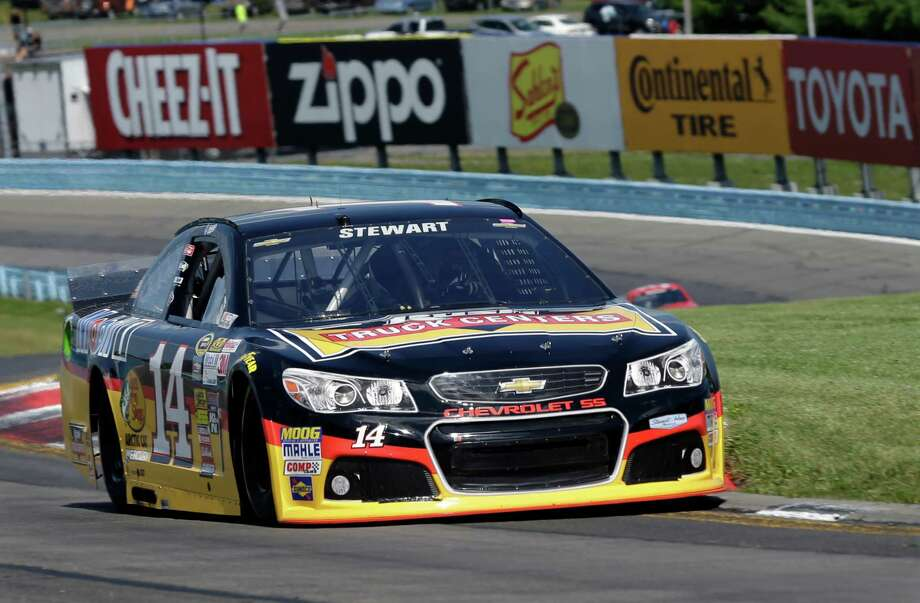 Tony Stewart (14) drives through the s-turns during a qualifying session for Sunday's NASCAR Sprint Cup Series auto race at Watkins Glen International, Saturday, Aug. 9, 2014, in Watkins Glen N.Y. Stewart struck and killed a sprint car driver who had climbed from his car and was on the track trying to confront Stewart during a race in upstate New York on Saturday night. Stewart was scheduled to race in in NASCAR's event Sunday at Watkins Glen.  (AP Photo/Mel Evans)   ORG XMIT: NYME101 Photo: Mel Evans / AP