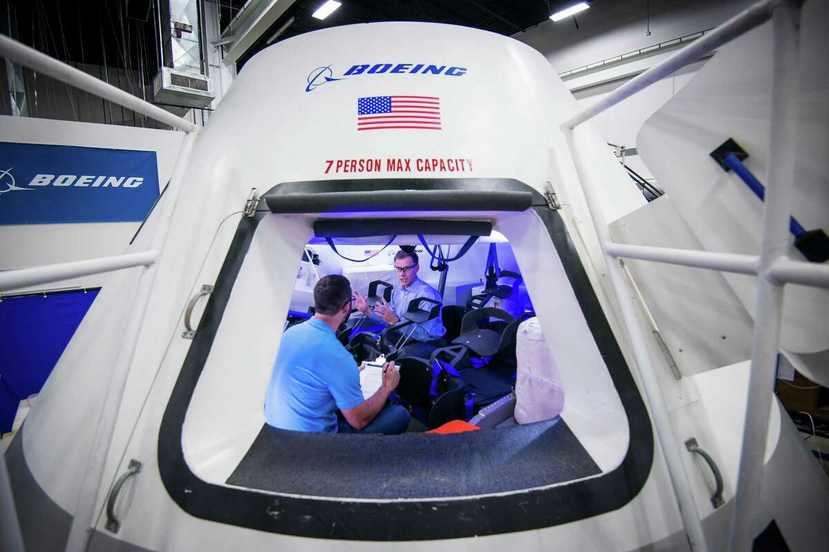 Chris Ferguson, director of Crew and Mission Operations for Boeing's Commercial Crew Program, facing, works with engineer Brandon Setayesh in a mockup of the CST-100 crew capsule at the the company's Houston Product Support Center on Thursday, July 24, 2014, in Houston. The capsule is Boeing's proposed spacecraft for NASA's Commercial Crew Development program. Ferguson, a former astronaut, commanded STS-135, the final Space Shuttle mission. ( Smiley N. Pool / Houston Chronicle )