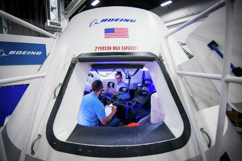 Chris Ferguson, director of Crew and Mission Operations for Boeing's Commercial Crew Program, facing, works with engineer Brandon Setayesh in a mockup of the CST-100 crew capsule at the the company's Houston Product Support Center on Thursday, July 24, 2014, in Houston.  The capsule is Boeing's proposed spacecraft for NASA's Commercial Crew Development program. Ferguson, a former astronaut, commanded STS-135, the final Space Shuttle  mission. ( Smiley N. Pool / Houston Chronicle ) Photo: Smiley N. Pool, Staff / © 2014  Houston Chronicle