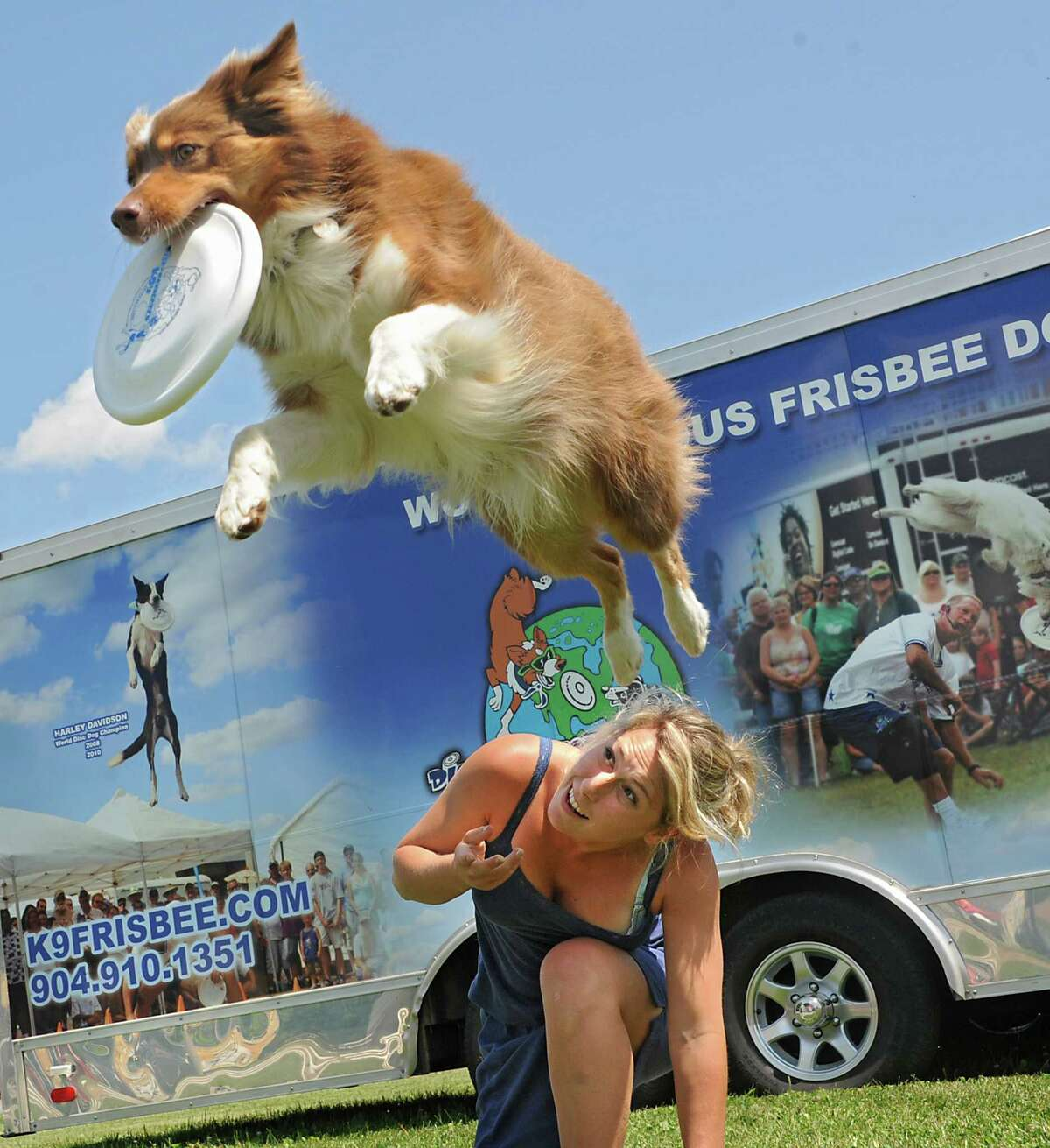 Marina Fangareggi of Italy takes a break from setting up to play frisbee with Australian Shepard Jolie at the Altamont Fair on Sunday, Aug. 10, 2014 in Altamont, N.Y. Marina and Jolie are with Disc Connected K9's world famous frisbee dogs attraction. The fair runs Aug. 12-17. (Lori Van Buren / Times Union)