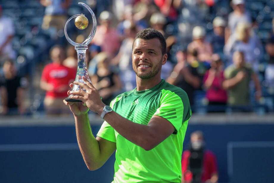 Jo-Wilfried Tsonga holds the Rogers Cup after defeating Roger Federer of Switzerland 7-5, 7-6 in the final of the Rogers Cup at Rexall Centre in Toronto, Ontario, August 10, 2014.  AFP PHOTO / Geoff RobinsGEOFF ROBINS/AFP/Getty Images Photo: GEOFF ROBINS, Stringer / AFP