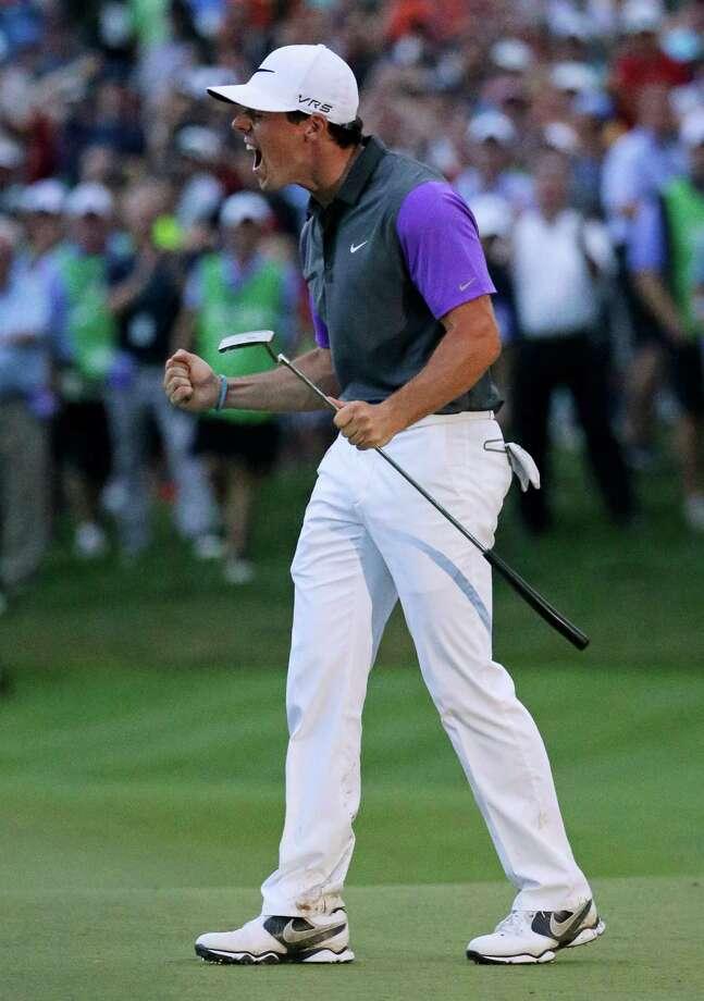 Rory McIlroy, of Northern Ireland, celebrates after winning the PGA Championship golf tournament at Valhalla Golf Club on Sunday, Aug. 10, 2014, in Louisville, Ky. (AP Photo/David J. Phillip) Photo: David J. Phillip, Associated Press / AP