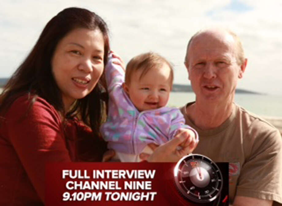 """In this image taken from video supplied Sunday, Aug. 10, 2014 by Channel 9's """"60 Minutes"""",  David Farnell, right, his wife Wendy, left, pose with baby Pipah in Australia. The Australian couple, David and his wife Wendy Farnell,  has denied that they abandoned their son born with Down syndrome to a Thai surrogate. The couple said in the interview that the boy's surrogate mother, Pattaramon Chanbua, insisted she be allowed to keep the boy and that she threatened to also keep his twin sister Pipah. (AP Photo/Channel 9 60 Minutes)  AUSTRALIA OUT, NO SALES, EDITORIAL USE ONLY Photo: HOPD / Channel 9 60 Minutes"""