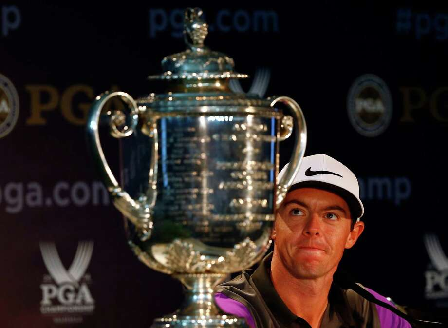 Rory McIlroy of Northern Ireland casts an admiring glance at the Wanamaker Trophy after his victory. Photo: Sam Greenwood, Staff / 2014 Getty Images