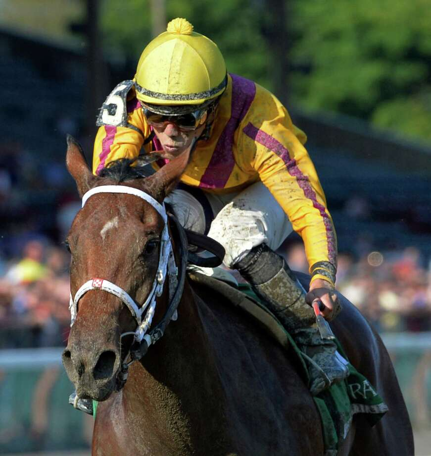 Cavorting ridden by Irad Ortiz Jr. finishes strongly to win the 98th running of The Adirondack Aug. 10, 2014  at the Saratoga Race Course in Saratoga Springs, N.Y.     (Skip Dickstein/Times Union) Photo: SKIP DICKSTEIN