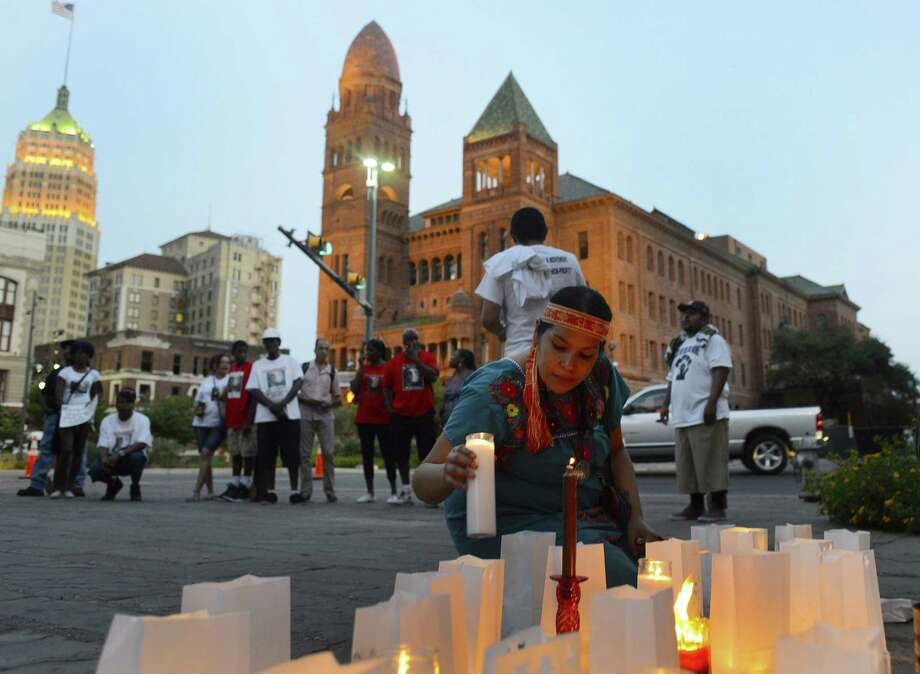 Monessa Maria Esquivel takes part in the vigil aimed at bringing attention to unaccompanied minors from Central America who have arrived in the U.S. and those who have died on the way. Photo: Billy Calzada / San Antonio Express-News / San Antonio Express-News