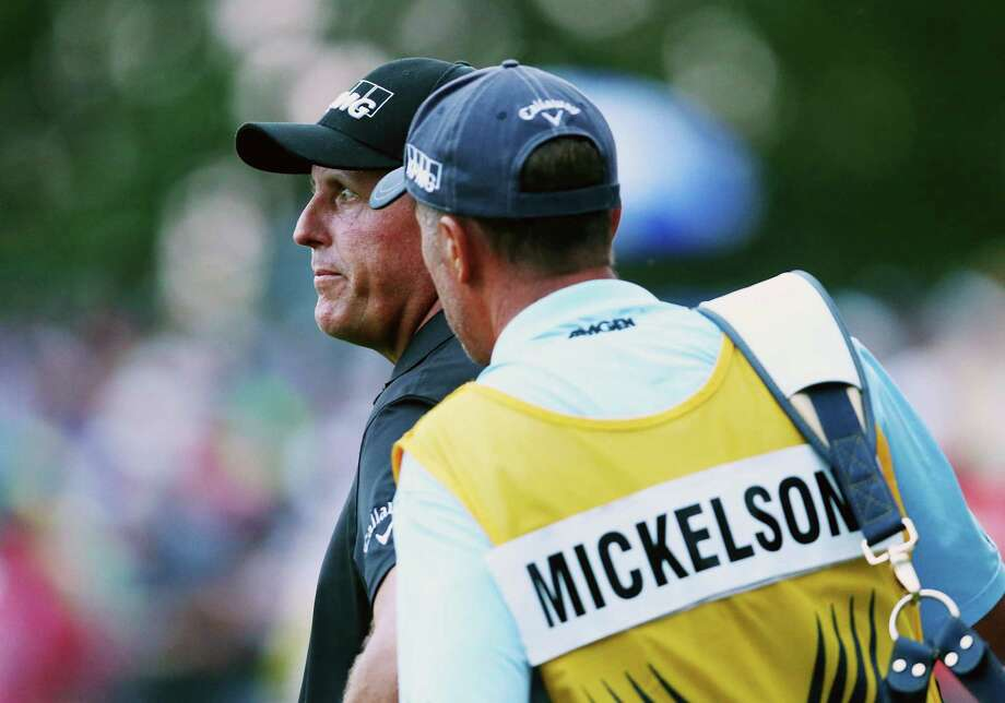 LOUISVILLE, KY - AUGUST 10:  Phil Mickelson of the United States waits on the 18th green alongside his caddie Jim Mackay during the final round of the 96th PGA Championship at Valhalla Golf Club on August 10, 2014 in Louisville, Kentucky.  (Photo by Jeff Gross/Getty Images) ORG XMIT: 461915719 Photo: Jeff Gross / 2014 Getty Images