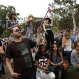 Festival-goers dance while Flume plays during Outside Lands festival at Golden Gate Park in San Francisco, Calif. on Sunday, August 10, 2014.