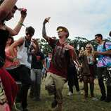 Eric Tresback, center, dances during an impromptu performance at Outside Lands Music Festival in Golden Gate Park on August 10, 2014 in San Francisco, CA.
