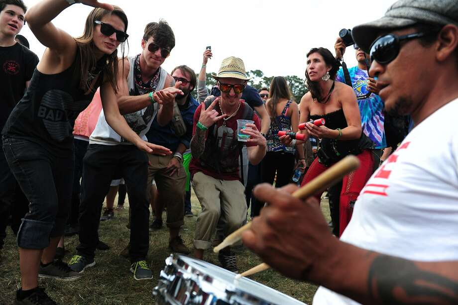 Festival goers such as Eric Tresback, center, and Matt Hook, left of Eric, dance during an impromptu performance at Outside Lands Music Festival in Golden Gate Park on August 10, 2014 in San Francisco, CA. Photo: Craig Hudson, The Chronicle