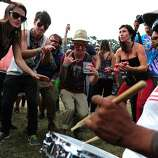 Festival goers such as Eric Tresback, center, and Matt Hook, left of Eric, dance during an impromptu performance at Outside Lands Music Festival in Golden Gate Park on August 10, 2014 in San Francisco, CA.