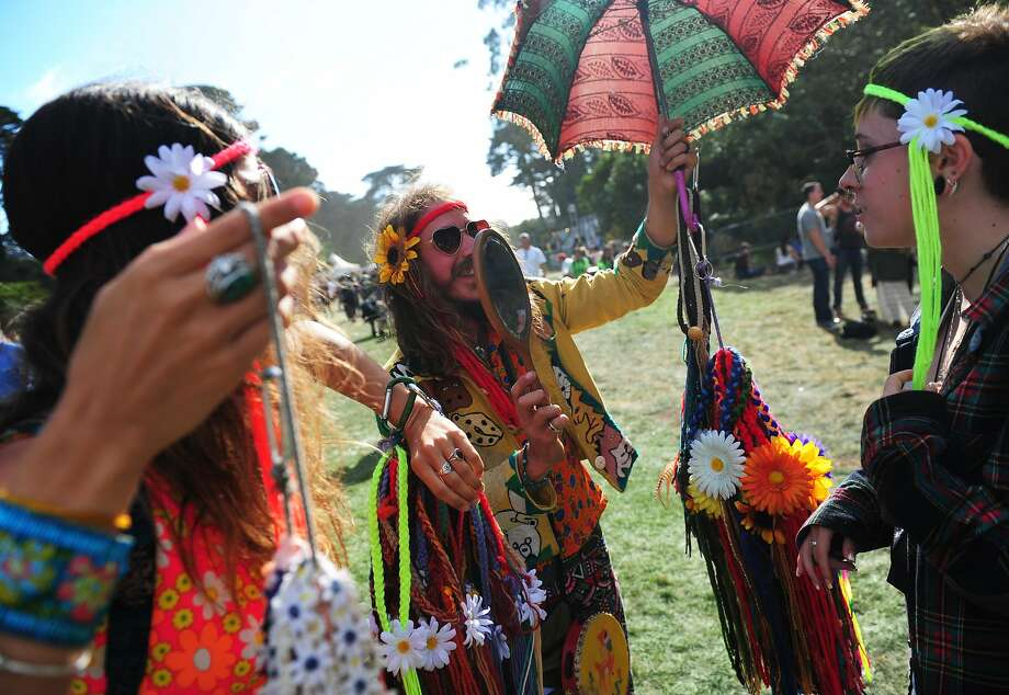 Emily Joy, left, and Alvaro Ramirez III show Danika Lutge how she looks with her headband on at Outside Lands Music Festival in Golden Gate Park on August 10, 2014 in San Francisco, CA. Photo: Craig Hudson, The Chronicle