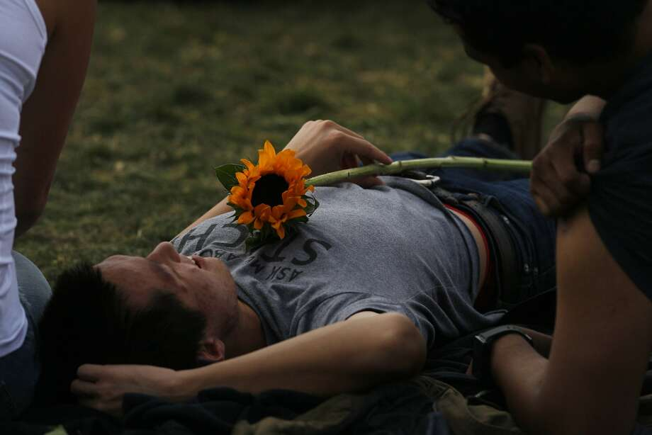 A festival goer holds a sunflower at Outside Lands Music Festival in Golden Gate Park on August 10, 2014 in San Francisco, CA. Photo: Craig Hudson, The Chronicle