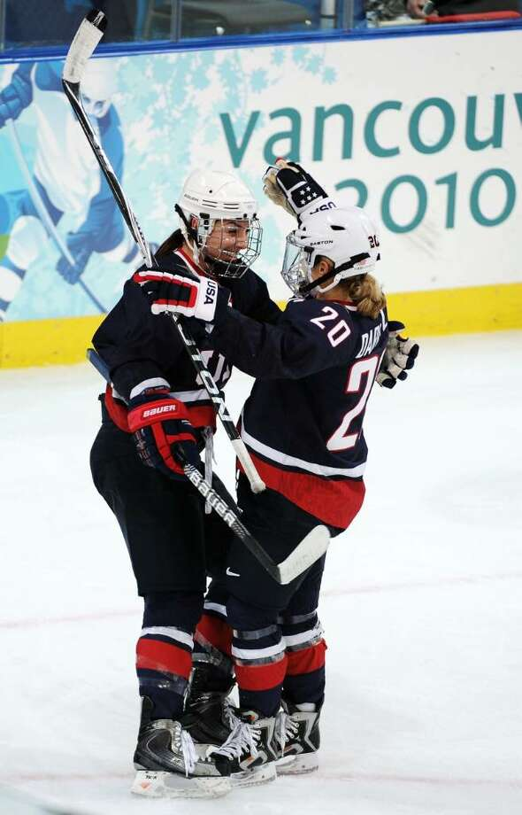 VANCOUVER, BC - FEBRUARY 18: Hilary Knight of the United States celebrates her goal with teammate Natalie Darwitz to make it 2-0 during the ice hockey women's preliminary game between USA and Finland on day 7 of the 2010 Vancouver Winter Olympics at UBC Thunderbird Arena on February 18, 2010 in Vancouver, Canada.  (Photo by Harry How/Getty Images) *** Local Caption *** Hilary Knight;Natalie Darwitz Photo: Harry How, Getty Images / 2010 Getty Images