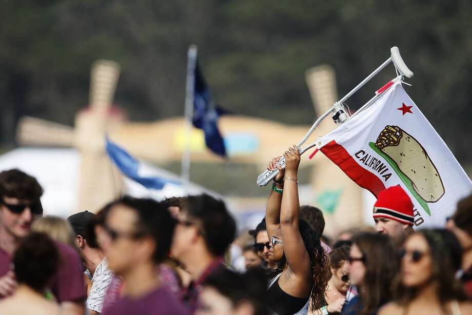 A woman holds a flag on the Polo Field at Outside Lands Music Festival in Golden Gate Park on August 10, 2014 in San Francisco, CA. Photo: Craig Hudson, The Chronicle