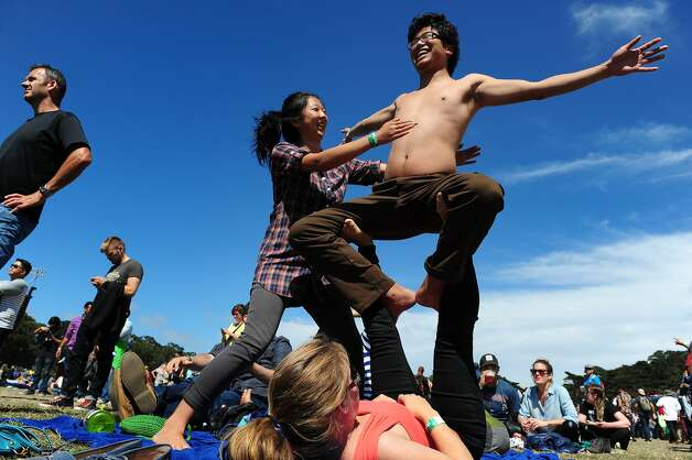 Hannah Yang helps balance Holman Gao as Amanda Bullington holds him up as they practice acro-yoga at Outside Lands Music Festival in Golden Gate Park on August 10, 2014 in San Francisco, CA. Photo: Craig Hudson, The Chronicle