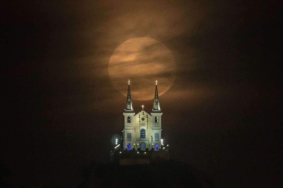TOPSHOTS The full moon descends behind the Nossa Senhora da Penha Church in Rio de Janeiro, Brazil, on August 10, 2014. In this time of the year the orb is at the closest point to the earth. Experts name this phenomenon the supermoon or perigee. AFP PHOTO / YASUYOSHI CHIBAYASUYOSHI CHIBA/AFP/Getty Images