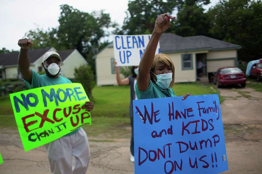 About 25 residents and members of the Texas Organizing Project rallied for more cleanup at the shuttered CES Environmental Services. Photo: Johnny Hanson, Staff / © 2014  Houston Chronicle