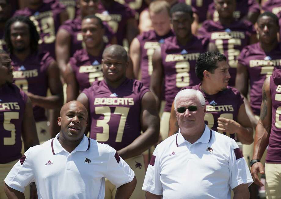 Coach Dennis Franchione (front right), secondary coach Jason Washington (front left) and the Bobcats take part in media day Sunday on the heels of a 6-6 season that ended without a bowl. Photo: Photos By Darren Abate / For The Express-News