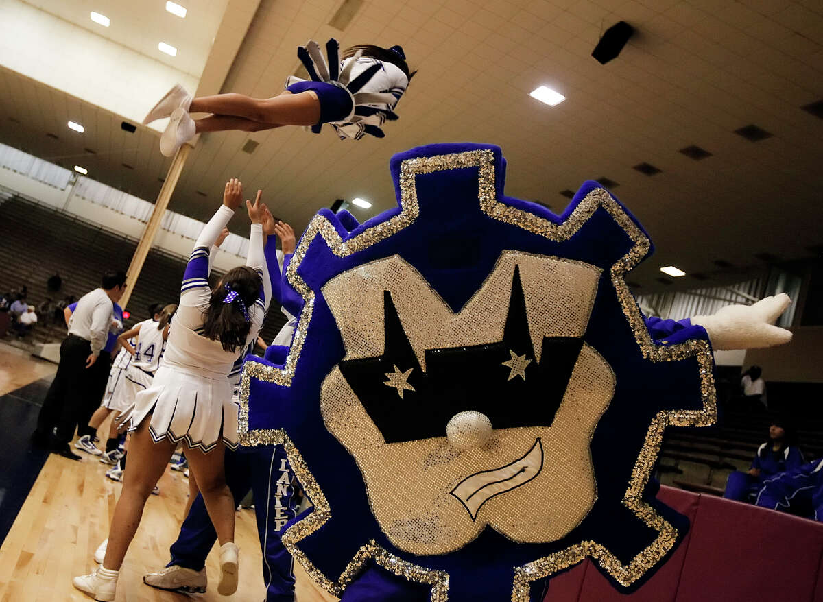 The Lanier High School mascot and cheerleaders had much to celebrate as their girls' varsity basketball team went on to defeat Burbank, 76-57, at the Alamo Convocation Center on Tuesday, Jan. 26, 2010. Kin Man Hui/kmhui@express-news.net