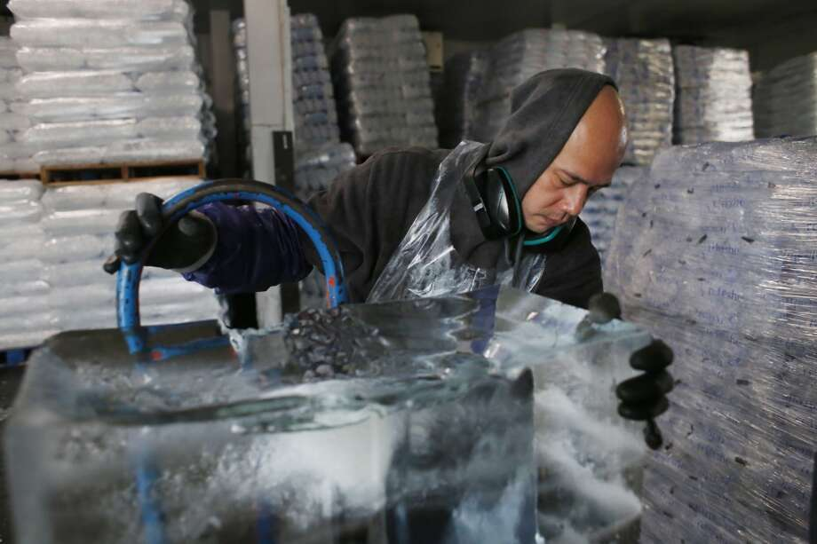 Master ice sculptor Anthony Soriano moves pristine block of ice from the freezer at the San Francisco Ice Company in San Francisco, Calif. Photo: Mike Kepka