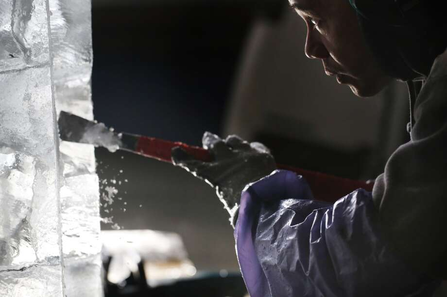 With a razor sharp chisel, master ice sculptor Anthony Soriano makes precise cuts in a 300 pound block of ice at the San Francisco Ice Company in San Francisco, Calif. Photo: Mike Kepka