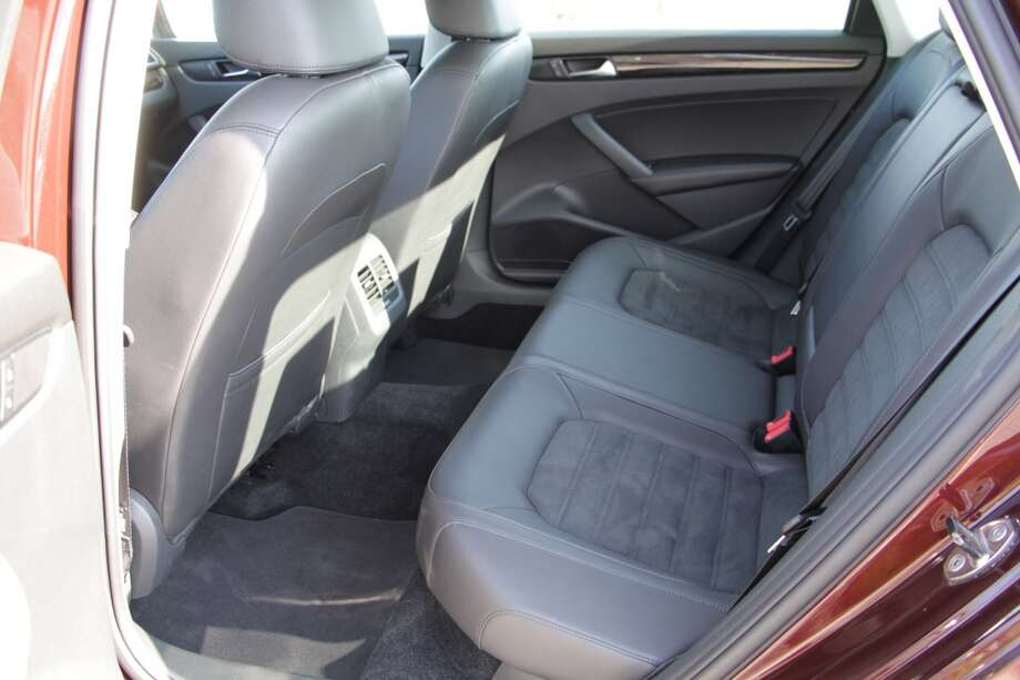 The Passat is a comfortable four-door sedan that is designed to carry four or five people. The rear seats have enough legroom for passengers to ride a few hundred miles without getting cramped.