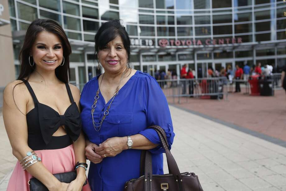 Lisa Zeve, left, and Santos Shaver a before the Marco Antonio Solis concert at Toyota Center Sunday, Aug. 10, 2014, in Houston. ( Johnny Hanson / Houston Chronicle ) Photo: Johnny Hanson, Houston Chronicle