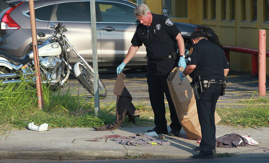 San Antonio police investigate the scene of an accident Monday August 11, 2014 at South General McMullen and Amaya Calle. Police said a man in his 40s going northbound on a motorcycle collided with a southbound blue pickup truck. The man is in serious condition and was transported to University Hospital. Photo: JOHN DAVENPORT, San Antonio Express-News / ©San Antonio Express-News/John Davenport