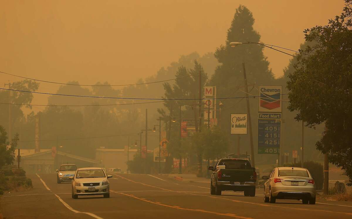 Downtown Laytonville, Calif., is socked in with smoke along Highway 101, Friday Aug. 8, 2014 from the Lodge Fire Complex. The fire was started by lightning on July 30 and has grown to 5,400 acres. (AP PhotoThe Press Democrat, Kent Porter)