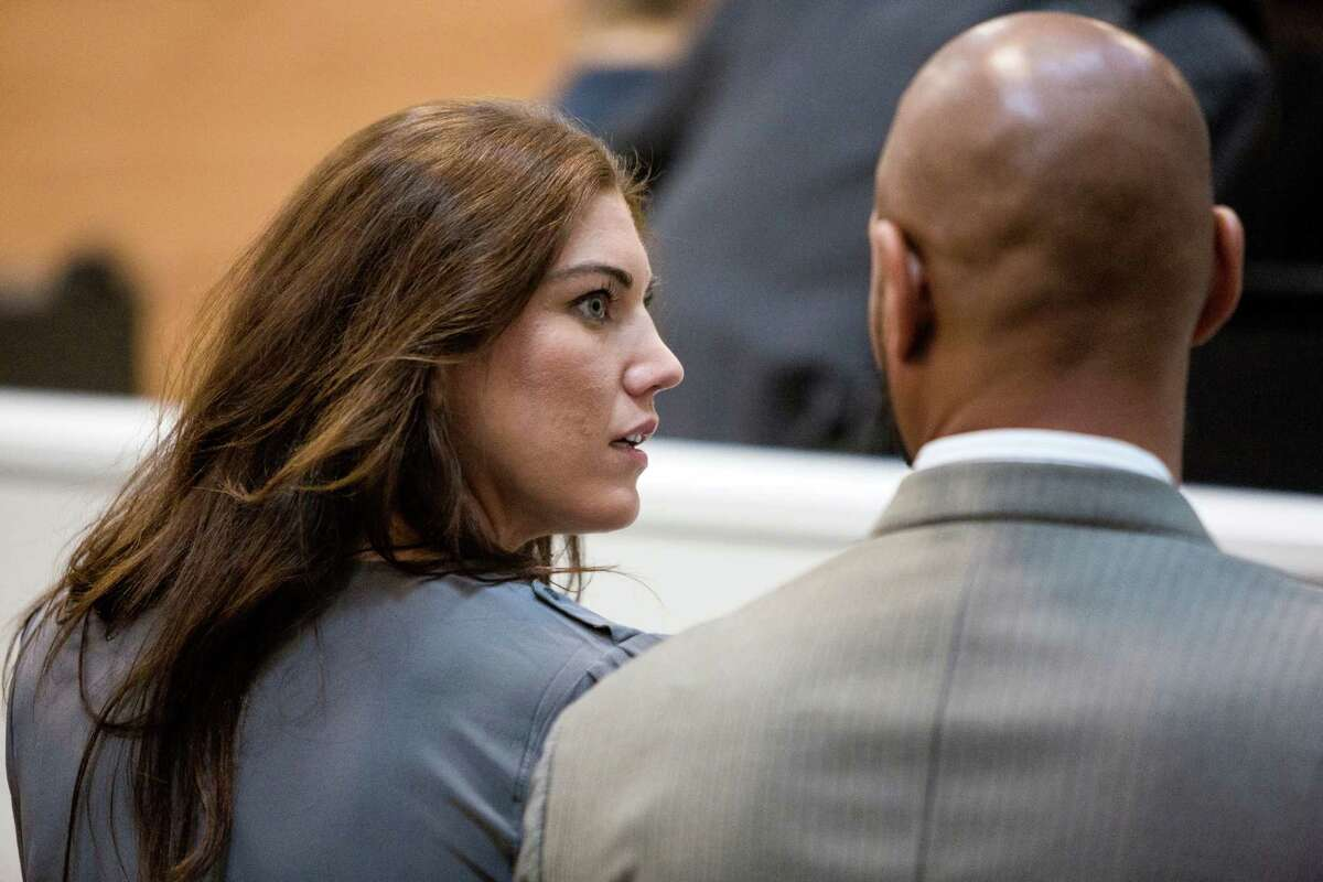 U.S. soccer star and UW graduate, Hope Solo, also known as Hope Stevens, also known as Hope Stevens, left, appears alongside her husband, former Seahawks tight end Jerramy Stevens, right, in the Kirkland Municipal Court Monday, Aug. 11, 2014, in Kirkland, Wash. Marking her second appearance in court, Solo requested another, later court date. Hope Solo pleaded not guilty in domestic violence case in mid-June.