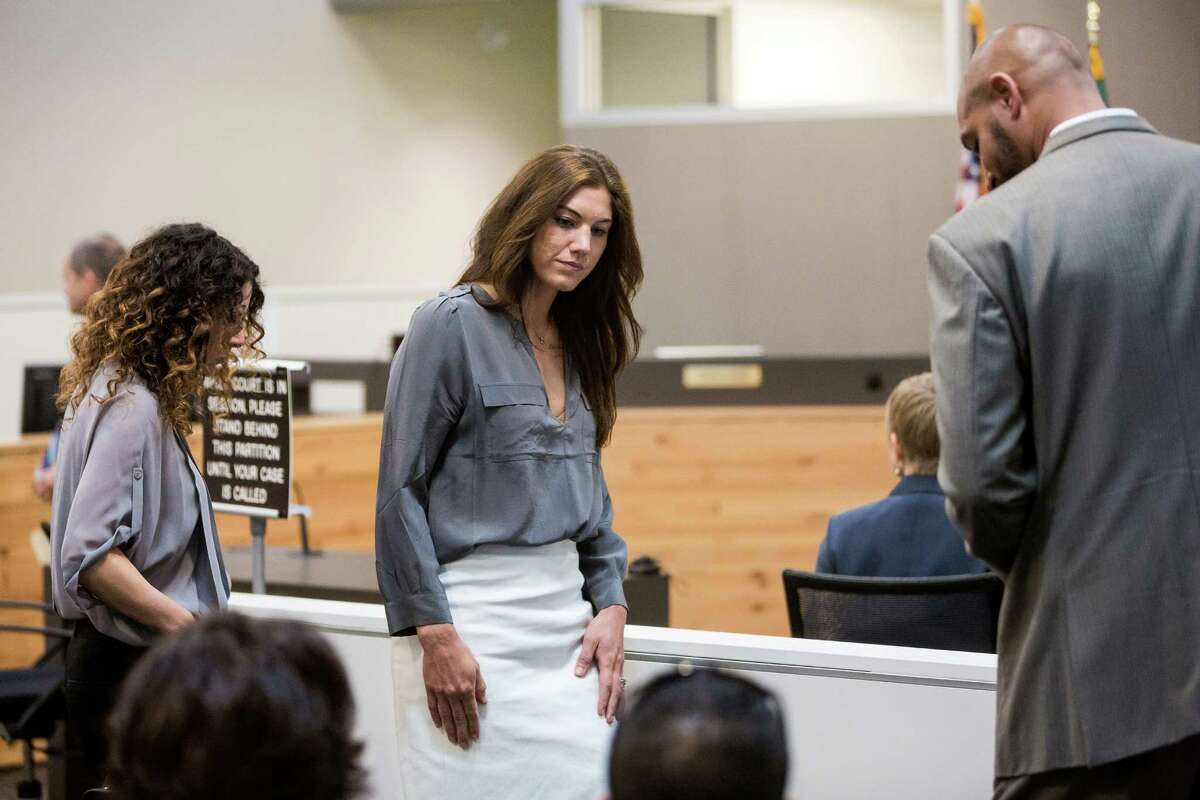 U.S. soccer star and UW graduate, Hope Solo, also known as Hope Stevens, center, appears in the Kirkland Municipal Court Monday, Aug. 11, 2014, in Kirkland, Wash. Marking her second appearance in court, Solo requested another, later court date. Hope Solo pleaded not guilty in domestic violence case in mid-June.